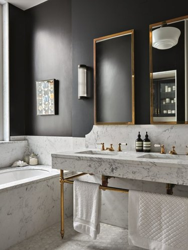 black and white bathroom with marble flooring and walls