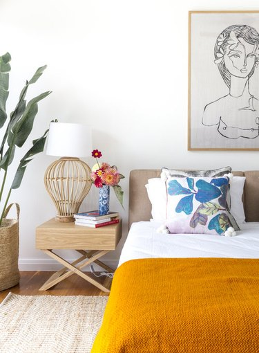 tropical bedroom with orange throw and accent pillows