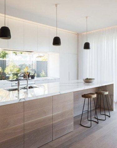Consider bleaching your kitchen wood floors to match your cabinets.