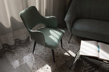 accent chairs in afternoon sunlight; tile floors