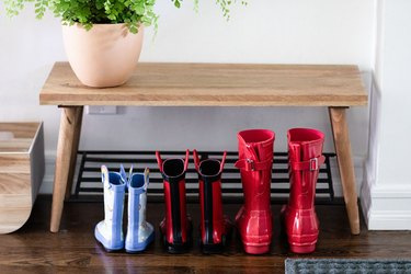 close up of rain-proof boots under a bench
