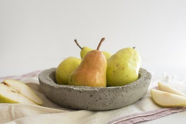Concrete bowl holding pears.