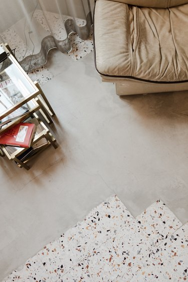 top view of chair and side table with tile flooring