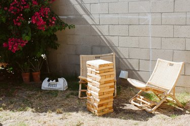 Outdoor idea with giant Jenga and patio chairs in backyard