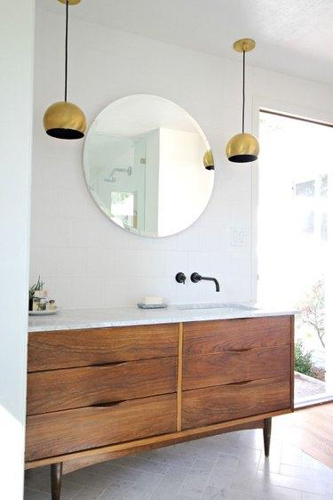 modern bathroom with marble flooring in herringbone pattern