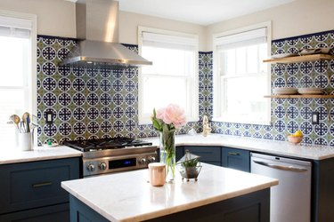 Blue and green Mexican tile backsplash in traditiional kitchen