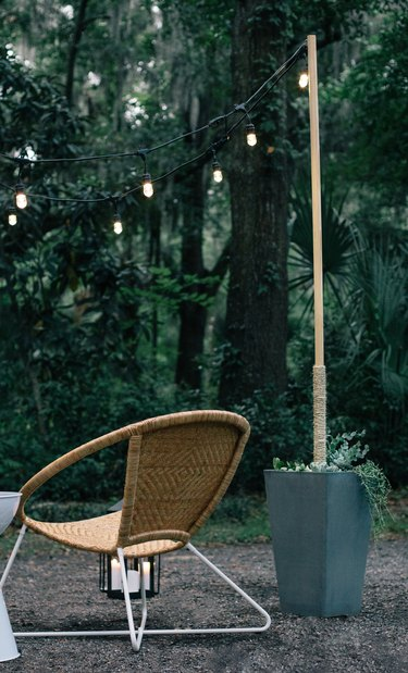 Outdoor idea with modern outdoor chair and string lights