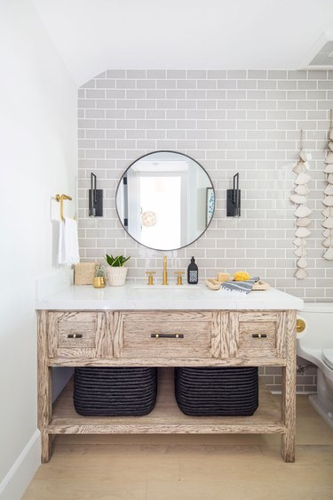 half bathroom idea with gray subway tile and wood vanity cabinet