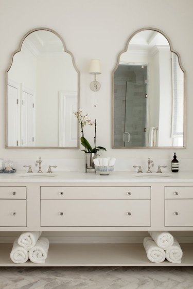white bathroom countertop in classic design with beige vanity cabinet