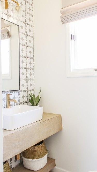 half bathroom idea with brass fixtures and vessel sink
