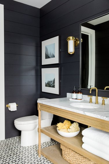 half bathroom idea with black shiplap walls and patterned floor tile