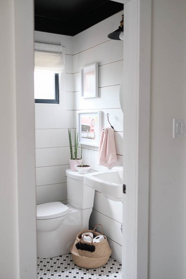 farmhouse bathroom with shiplap walls and black ceiling