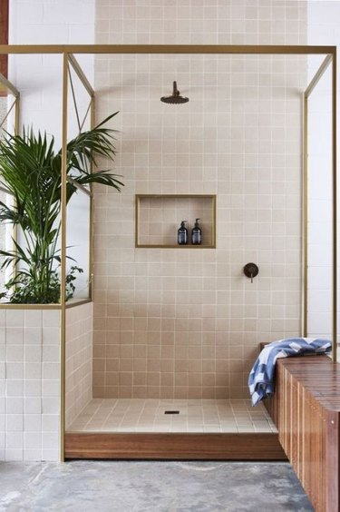 dusty pink open shower with brass frame