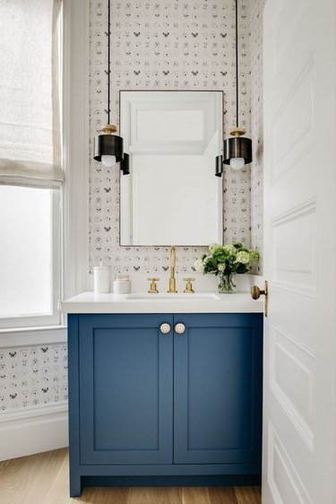 half bathroom idea with blue cabinet and pair of pendant lights