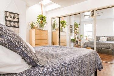 bedroom closet with mirrored sliding doors
