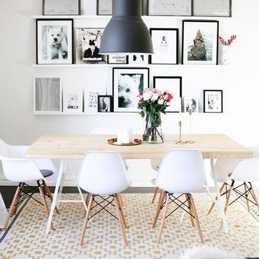 floating dining room shelves from IKEA filled with artwork and photographs