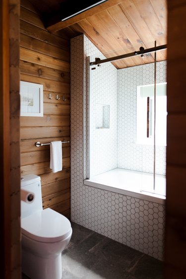 Rustic shower idea with wood planks and white honeycomb tile
