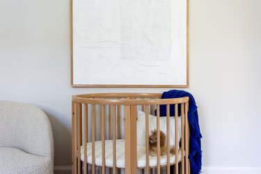 crib in a small guest room nursery combo