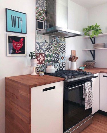 mixed cement tile stove backsplash butcher block waterfall counter