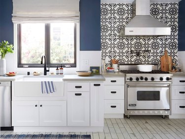 patterned cement tile backsplash in traditional blue and white kitchen