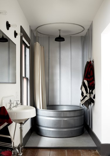 Rustic shower idea with galvanized metal bathtub and galvanized metal walls