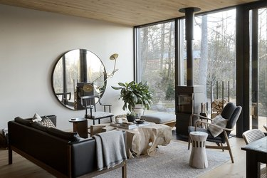 contemporary gray living room with wood stove fireplace