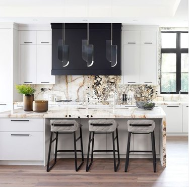 timeless black and white kitchen with onyx countertop