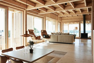 modern wooden Swedish beach house with wood stove fireplace