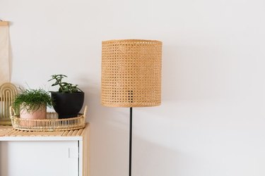 Floor lamp with cane lampshade.