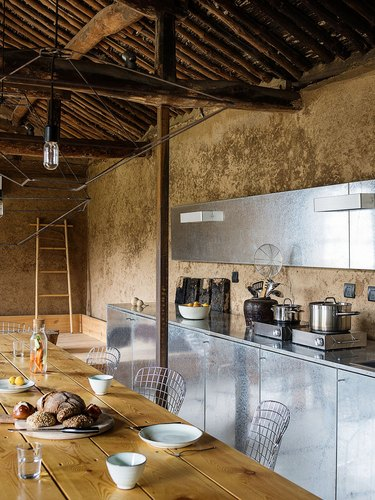 rustic kitchen with stainless steel cabinets
