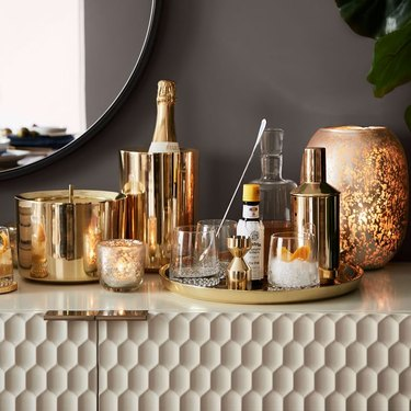 gold candles and bar tray