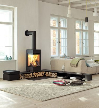 white loft with wood stove fireplace