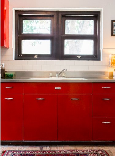 Red kitchen cabinets with stainless steel countertops