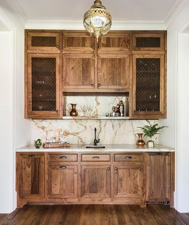 wood cabinetry with onyx countertop