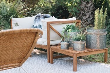 Outdoor herb garden in tin planters on patio.