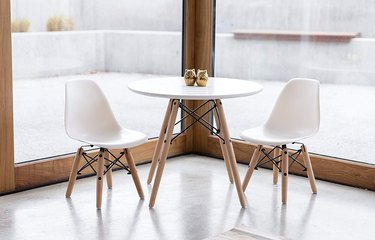 White and wood midcentury dining set for kids with round table and two chairs