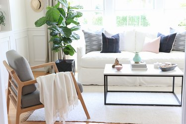 Midcentury modern bohemian living room with linear furniture and white colors