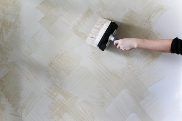 painting a wall with beige