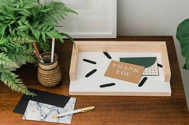 Desk tray organizer made of wood on desk.