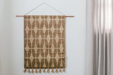 Rug wall hanging in bedroom.