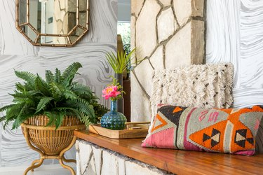 Midcentury modern bohemian entryway with colorful throw pillow and neutral colors