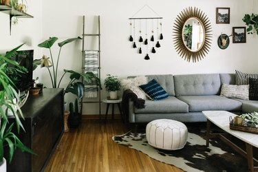 Midcentury modern bohemian living room with eclectic wall decor and midcentury sofa