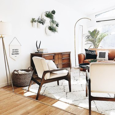 Midcentury modern bohemian living room with plants and midcentury furniture