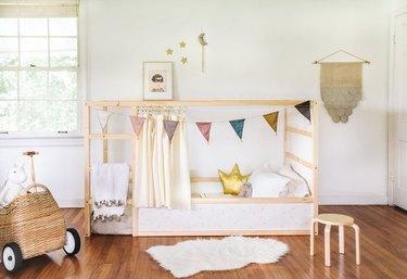 IKEA Kura bed in kid's bedroom.