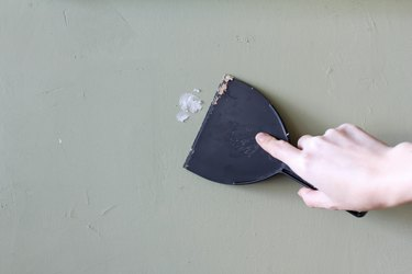 Spackling a hole in the wall