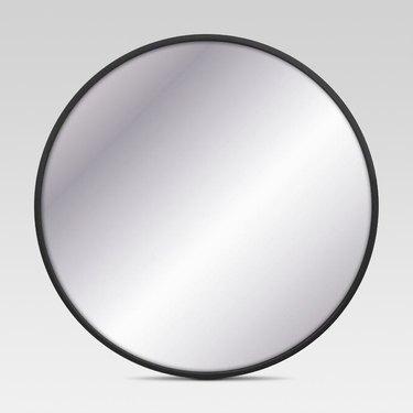 Circular wall mirror with thin black border