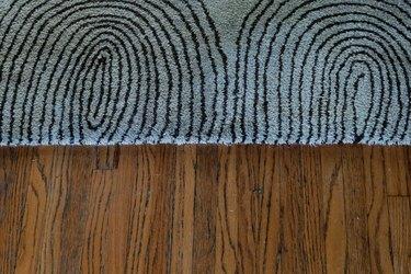 close up of carpet on wood floor