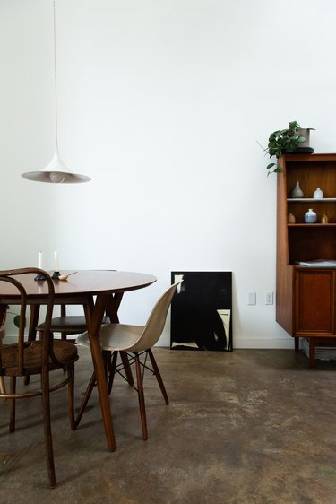 minimalist dining room table with concrete flooring