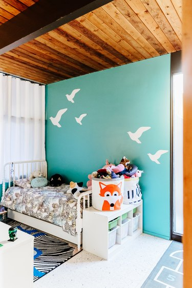 kids' bedroom ideas with storage bins filled with toys and cubbies with storage bins