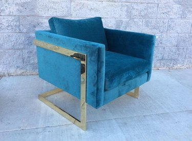 blue chair in Hollywood Regency style
